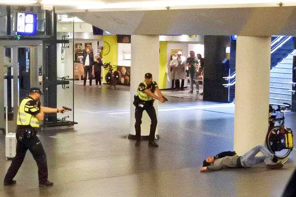 Dutch police officers wounded a 19-year-old Afghan man suspected of stabbing two Americans in Central Station in Amsterdam on Friday. (Credit: TDWHOLESALE via Associated Press)