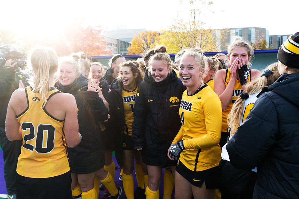 Iowa midfielder Makenna Grewe (center left) smiles as the Iowa field hockey team celebrates after the Semifinals in the Big Ten Field Hockey Tournament at Lakeside Field in Evanston, IL on Friday, Nov. 2, 2018. The no. 8 ranked Hawkeyes defeated the no. 7 ranked Wolverines 2-1.