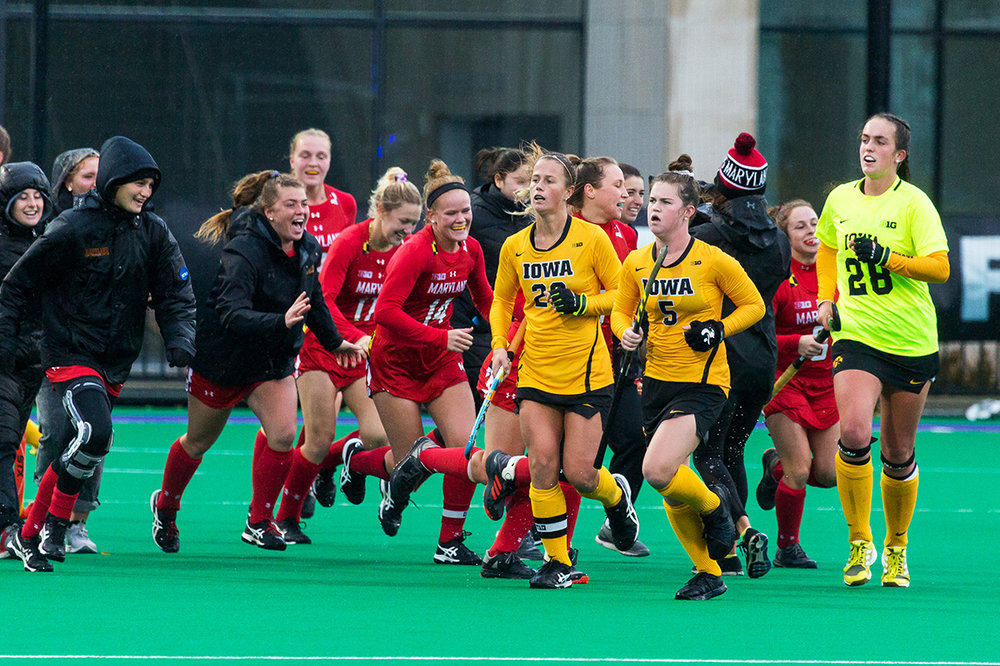 Iowa players jog off the field as Maryland players run on to the field after the Championship Game in the Big Ten Field Hockey Tournament at Lakeside Field in Evanston, IL on Sunday, Nov. 3, 2018. The no. 2 ranked Terrapins defeated the no. 8 ranked Hawkeyes 2-1.