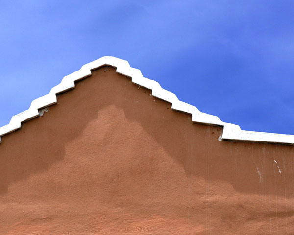 CARIBBEAN HOUSE, ORANGE AND WHITE ON BLUE
