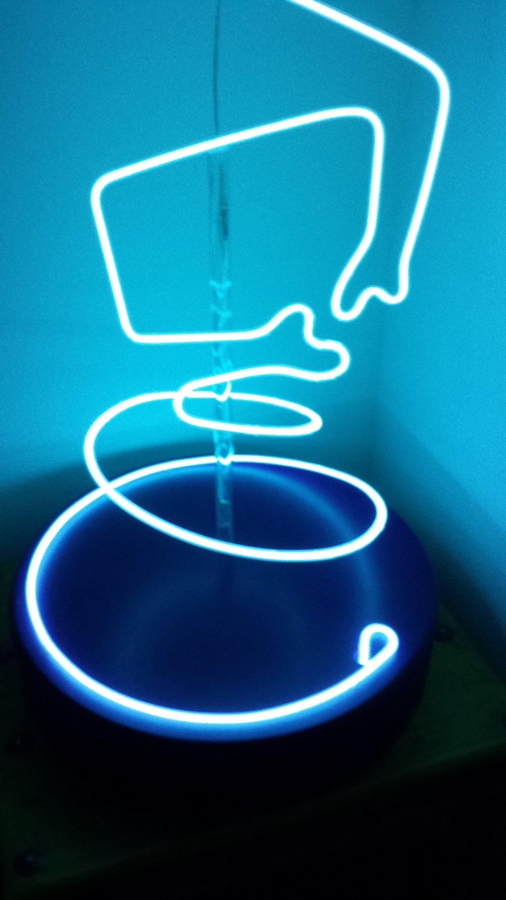 "TWISTY DANCER DETAIL 2.  Approximately 38"" x 50"", white-blue light on dark blue wood base."