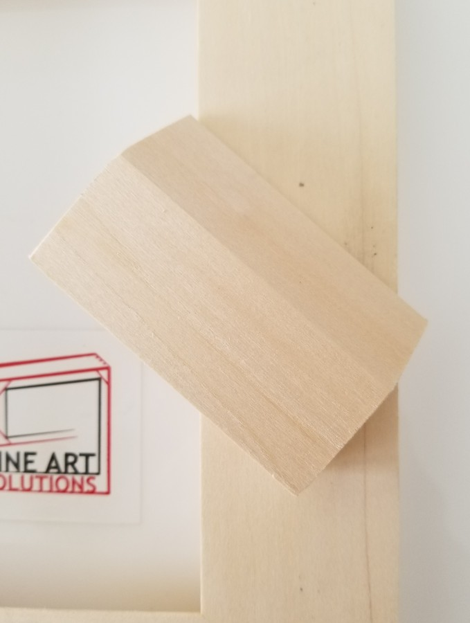 French Cleat mounting solution example 1 (the back of the print shown here).  Attach the small wood piece to the wall and simply slip the print over it for an interlocked, secured hanging.