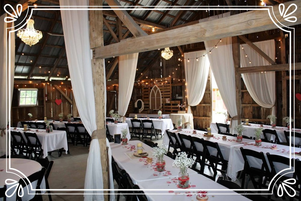 The Barn - Situated on a 200 acre Christmas tree farm, the Barn is a 1,599 sqft barn capable of seating 160 patrons with additional seating available outside. Muslin curtains drape the entrance and the Barn is decorated with elegant crystal chandeliers and string globe lights.
