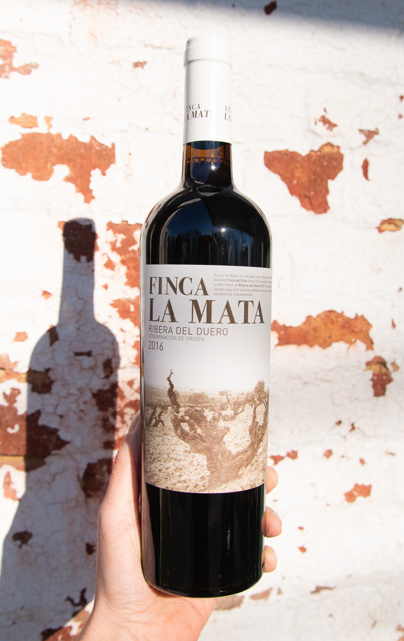 Finca La Mata 2016 - Retail: $19.95 | Sale $17.95Coming from 50 year old vines the fruit was hand harvested and sorted prior to destemming with a cooled pre-fermentation maceration which helped to attain a deep color and intense fruit aromas. Hints of incense and licorice, sappy black raspberry and blueberry flavors smoothly blend richness and vivacity and pick up a spicy nuance as the wine stretches out. Closes smooth, long and appealingly sweet, featuring sneaky tannins and an echo of ripe blue fruit.100% Tempranillo