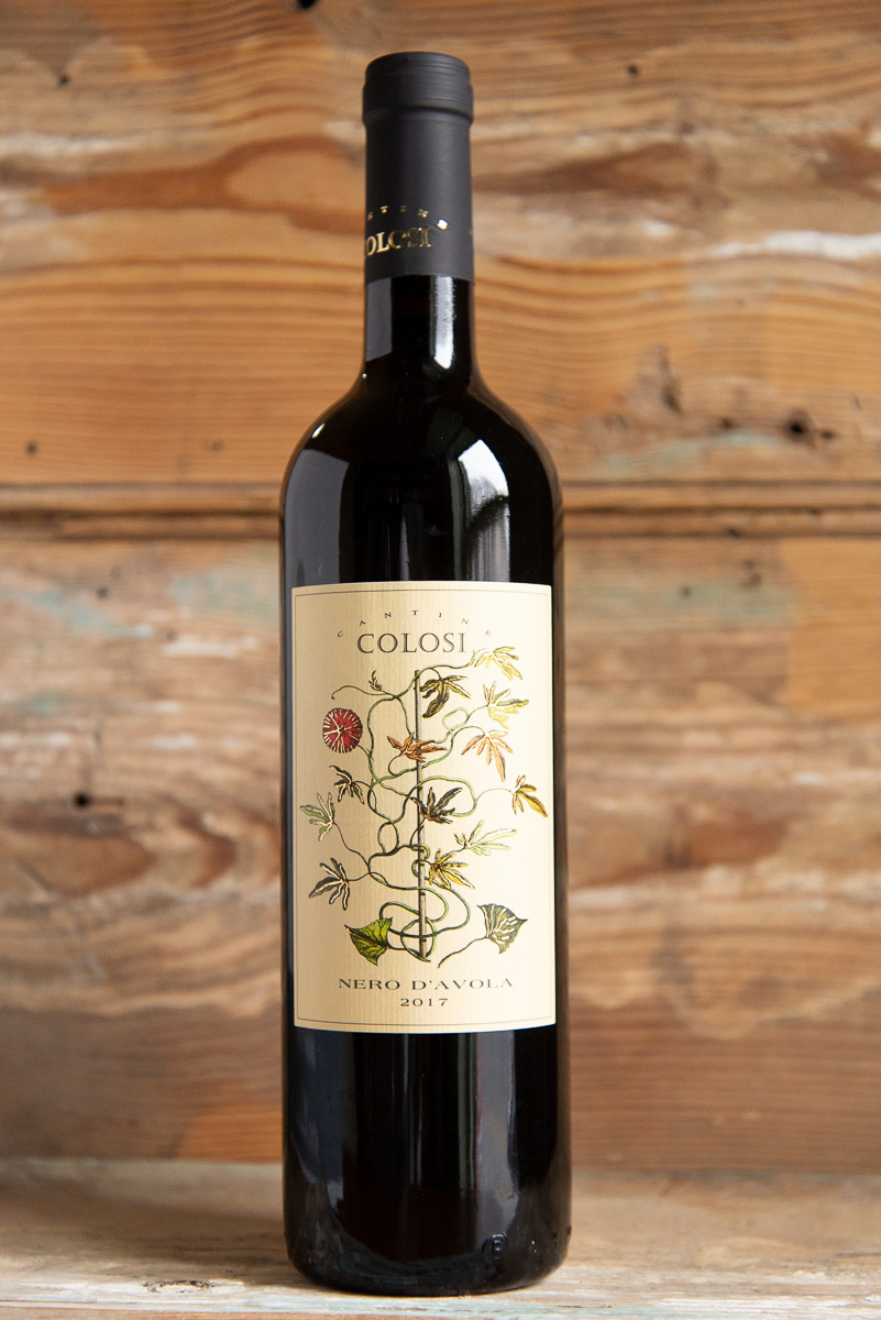 Cantina Colosi Nero d'Avola 2017 - Retail: $17.95 | Sale $16.15Run by a father and son team, Cantina Colosi is one of Sicily`s most quality-conscious producers with vineyards planted on the volcanic soils of Northern Sicily and on the island of Salina. The varietal `Nero d`Avola` is a native Sicilian grape that has become very fashionable for its rich character and bold structure. There are hints of blueberry, blackberry, plum, and vanilla on the nose with a full-bodied spicy palate. It is a perfect pairing for red meats, pasta with tomato sauce, and aged cheeses.100% Nero d'Avola