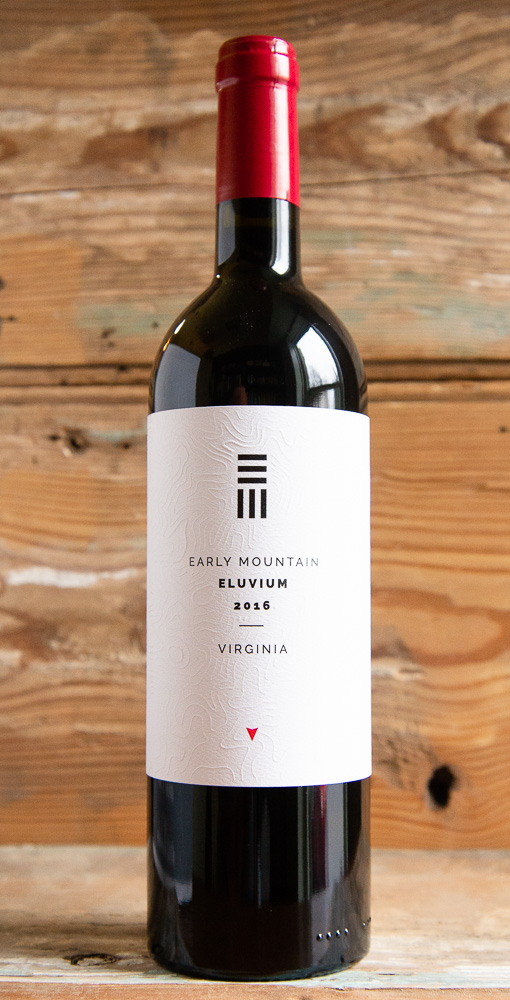 Early Mountain Eluvium 2016 - Origin: VirginiaRetail: $36.95 | Sale: $33.25The merlot for this blend comes from one of Early Mountains oldest vines in their Quaker Run Vineyard. The age of the vines contribute density and aromatic purity; presence and persistence with fine grain tannin. Petit Verdot contributes structure, depth, and power. On the nose the fruits are dark with plum and blackberry accentuated by sage, cedar and wood spice. The flavors echo the aromas; structured and layered with ample and persistent tannin. With higher proportion of Petit Verdot, there is a ruggedness to the structure, and in its youth the wine leads with this tannic texture. As a result, food pairings lean toward more rustic grilled and smoked red meat.56% Merlot | 44% Petit Verdot