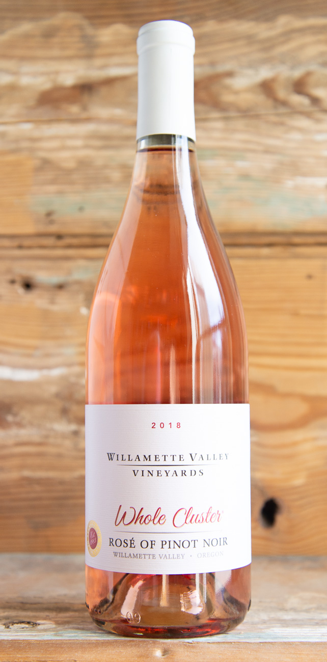 Willamette Vineyard Whole Cluster Rosé of Pinot Noir 2018 - Origin: OregonRetail: $21.95 | Sale $19.75This wine opens with vibrant aromatics of ruby red grapefruit, orange blossom, strawberry and watermelon. The palate is juicy and displays fresh raspberry, kiwi and floral honeysuckle flavors while remaining bright and balanced with refreshing acidity. The finish carries tropical papaya and guava essences well beyond the sip. Enjoy with complex, spicy and herbal dishes that highlight fresh spring and summer ingredients. Also enjoy with seafood like seared ahi tuna, shellfish and fish and chips, curried chicken salad and other pairings with harissa sauce, sweet potato fries, antipasto platters, or cheese plates.100% Pinot Noir90 Points Wine Enthusiast