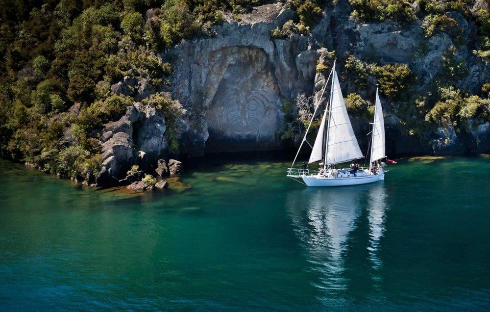 Sailing to the Mine Bay Maori Rock Carvings, Lake Taupo, Waikato.