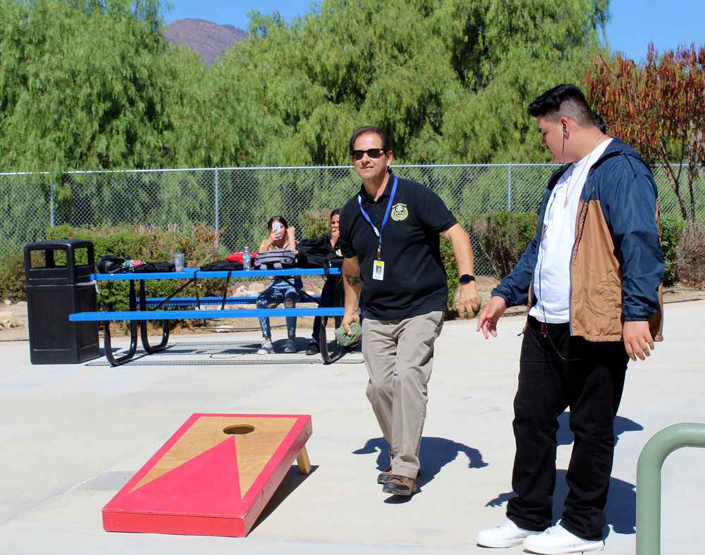 Teachers also compete in lunch time activities. Mr. Chavez, as always, showing the students his amazing corn-hole skills.