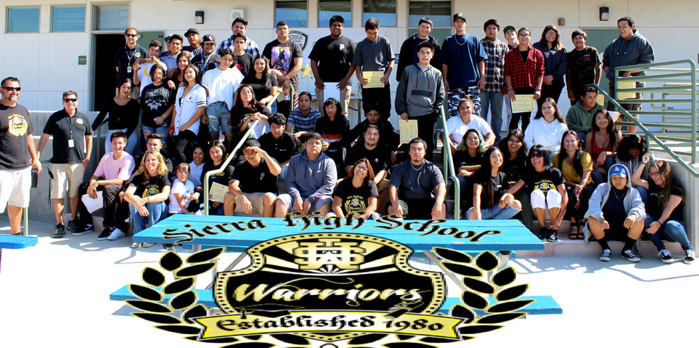 Sierra High staff and students taking a group photo and showing their school pride.