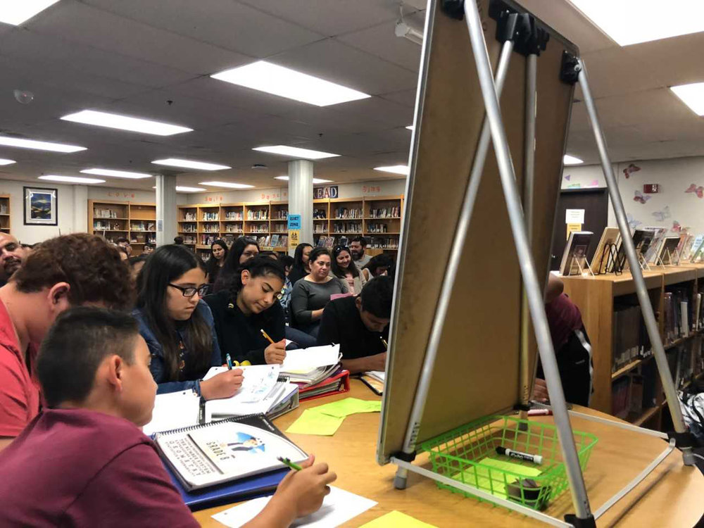 Students participate in a tutorial for AVID Parent Night at Fillmore Middle School.