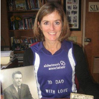 - Jane Lizotte daughter of the late Justice Francis O'Connor holding a portrait of her dad.