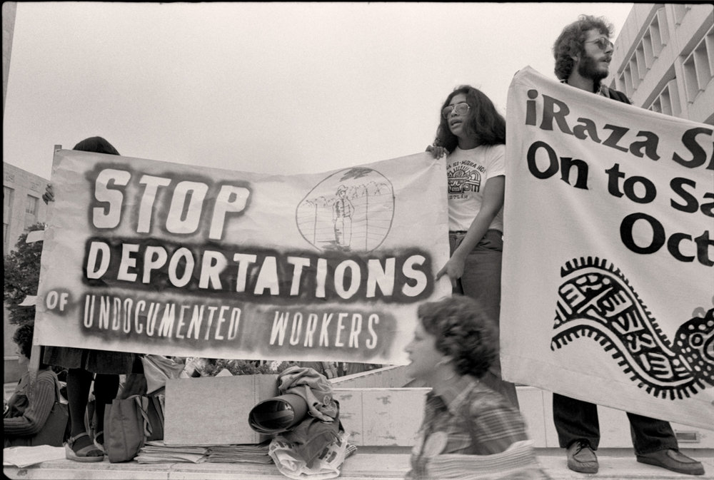 """Houston, 1977 - Outside the Convention Center, large groups demonstrated in support of the rights of immigrants a undocumented workers, who were being exploited and used as a political tool. Ray Marshall, US Secretary of Labor warned in 1977, with regard to discussion of immigration policy, """"there's the danger that some demagogue will feed popular fears."""""""