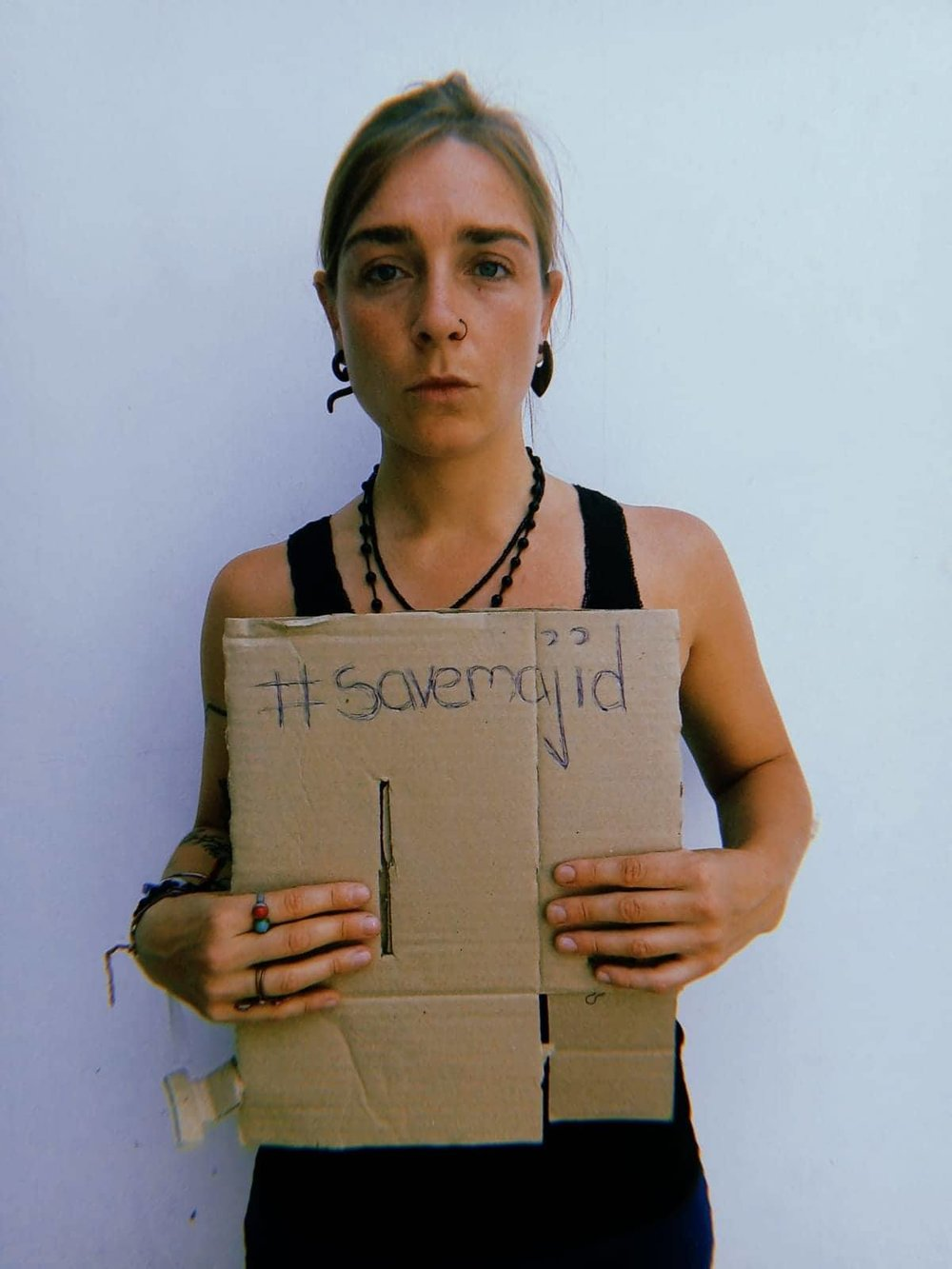 Patriz holding sign