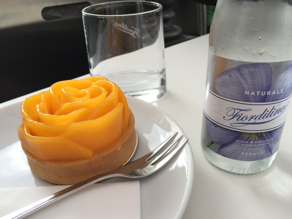 MAELU on Theatinerstraße (between Odeonsplatz and Marienplatz) has tiny cakes that are pieces of art. You should treat yourself to one! This is a mango cake.