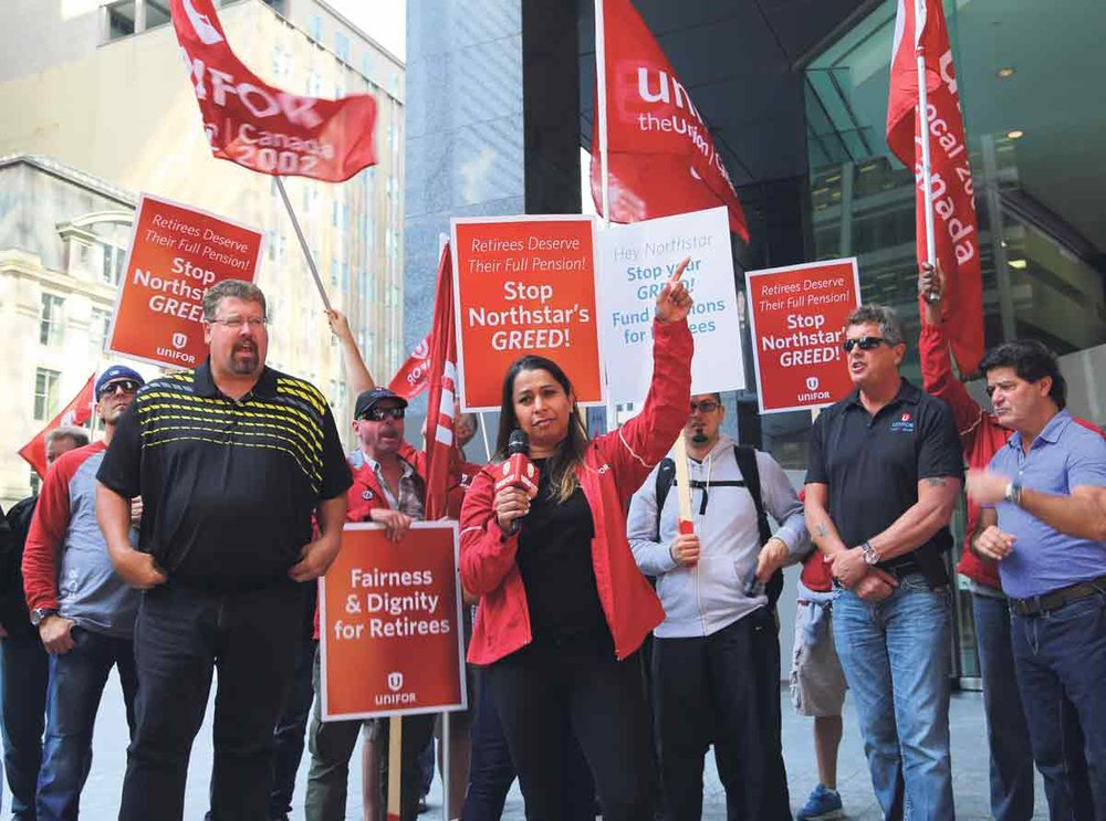 Scott McIlmoyle (left), chairperson, Unifor Ontario Regional Council, and Naureen Rizvi, (right) Unifor Ontario Regional Director, at a Toronto rally supporting workers at Northstar Aerospace, 2017  .  SUPPLIED