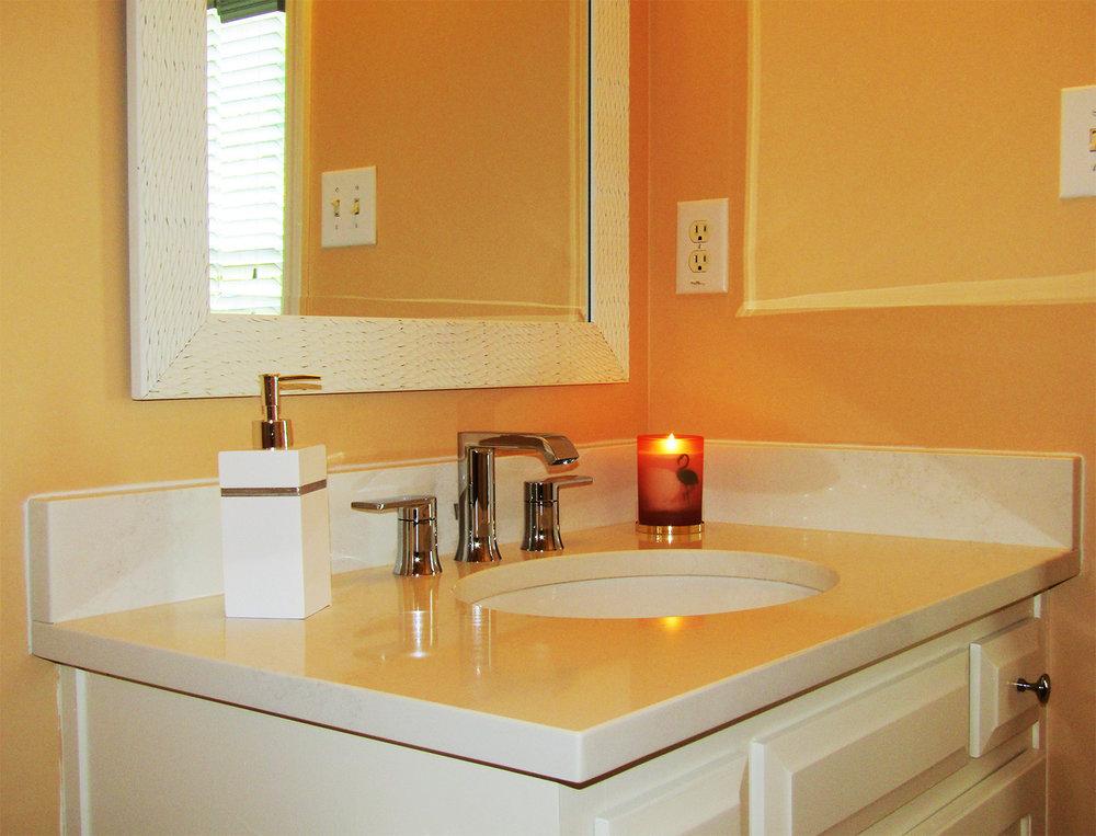 coral and cream bathroom interior design by BK Designs Atlanta Georgia