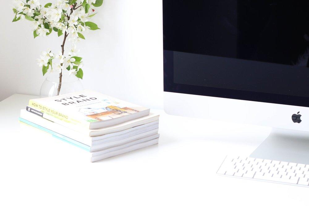 Computer wth books on desk.jpg