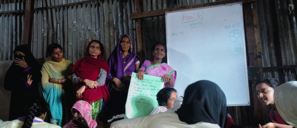 Attending a workshop on Women's Rights at Dharavi DIary.