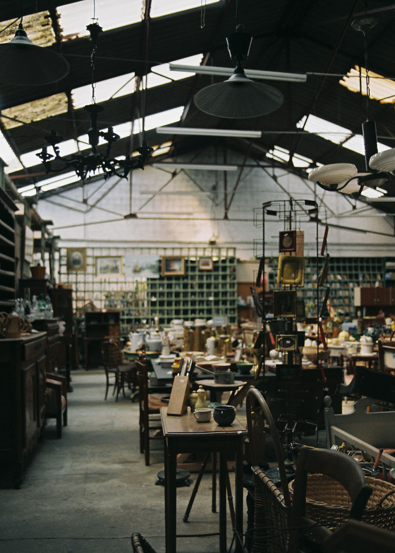 Flea markets, antique fairs, and salvage yards have provided many of the supports for the works in the exhibition.