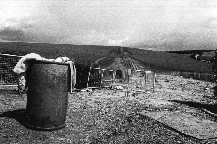 Club Culture as Rural Festival : Twyford Down, England, aftermath of field rave, three hours after the eviction of sound systems and dancers (From  Locating the Wild Zone  by Ian McKay, 2001). (Photo: © Ian McKay)