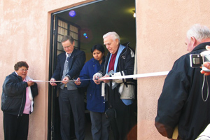 Dr. Dennis Pruett cutting the ribbon.