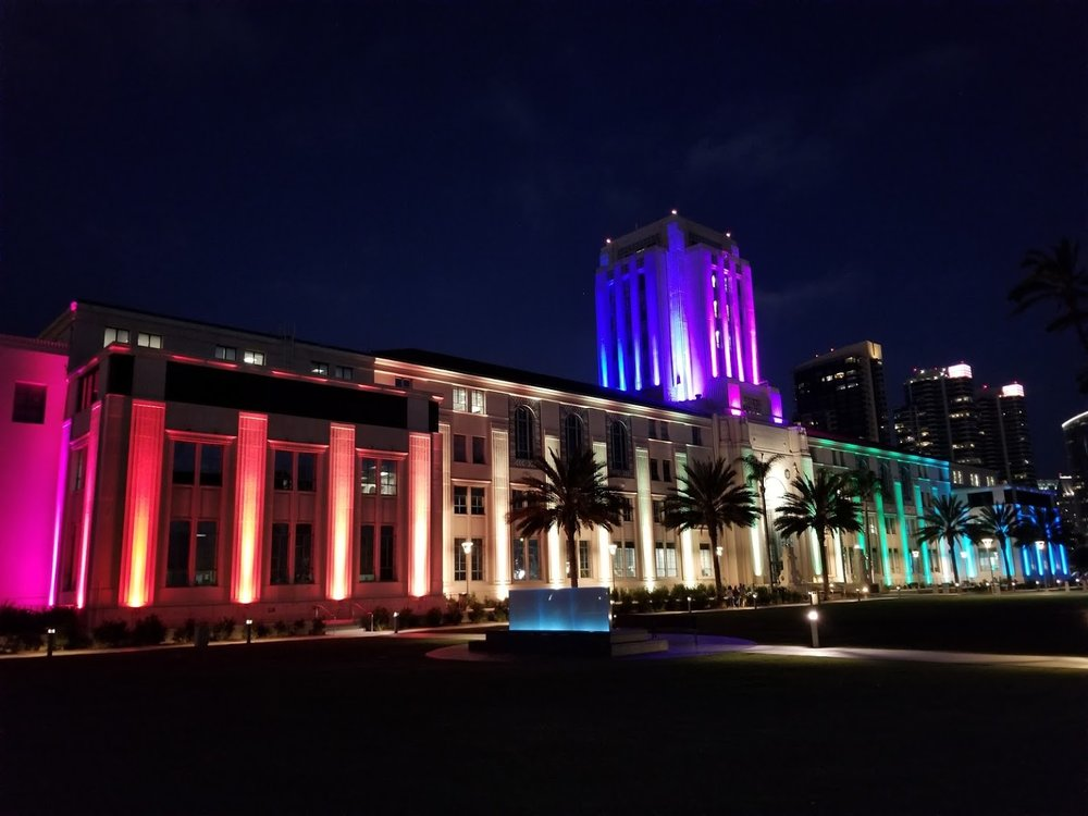 Administration Center building illuminated in rainbow lights