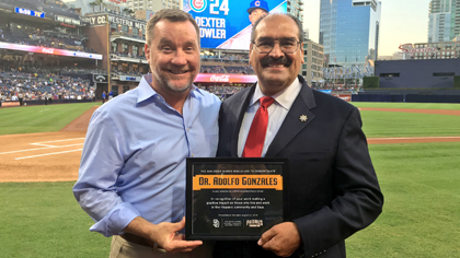 Probation Chief Adolfo Gonzales accepts his Communidad Award from Tom Seidler, Padres senior vice-president of community & military affairs, at the Aug. 23 game. Photo courtesy of San Diego Padres.