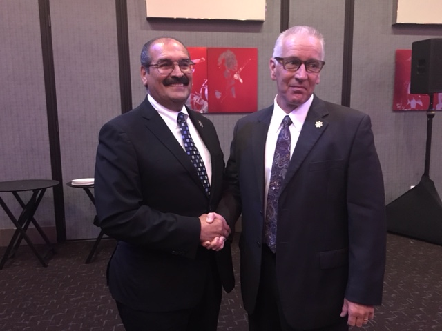 San Diego County Chief Probation Officer Adolfo Gonzales (left) congratulates Probation Officer David Pittman at the San Diego Police Officers Association award ceremony.