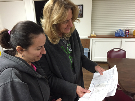Nancy Garcia and Loren Goldstein, Aging and Independence Services, inspect a map at the 2016 Point-in-Time homeless count.