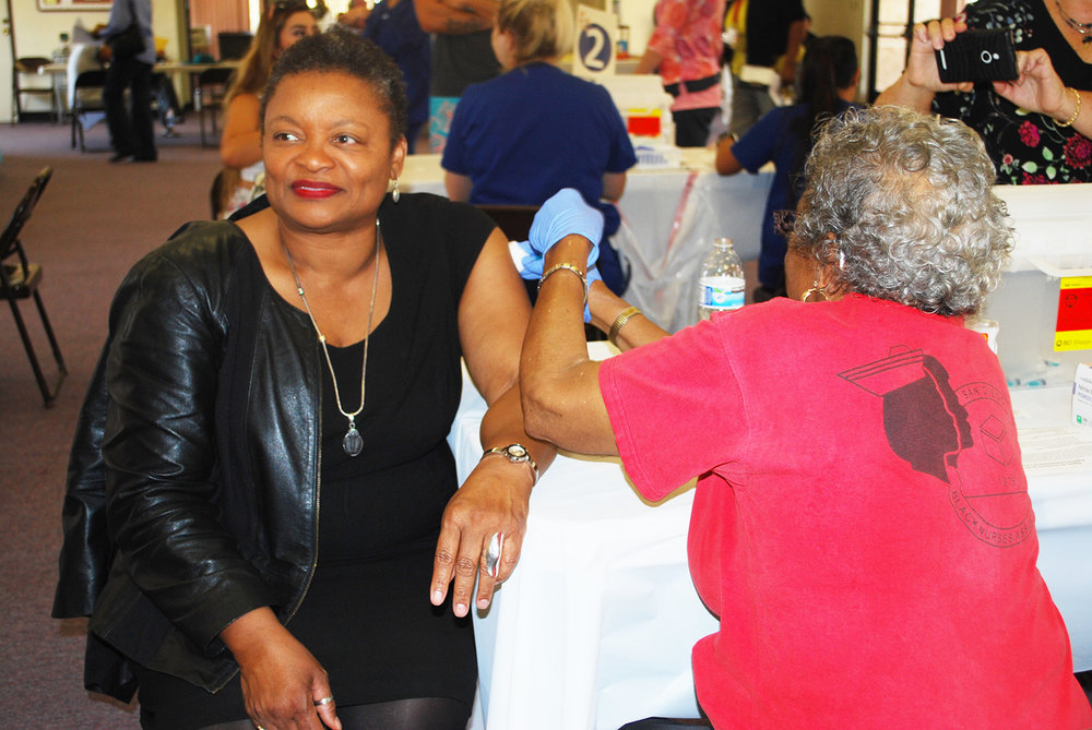 Wilma Wooten, M.D., M.P.H., County public health officer, Getting her Flu Shot.