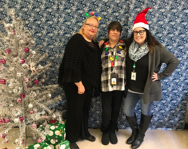 Ivonne Galvan, Simona Bentley and Sherry Brideau were three of the North Coastal Family Resource Center employees that participated in the Giving Tree project this holiday season.