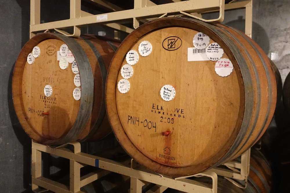 Process notes adorn the barrels in Cascade's cold store