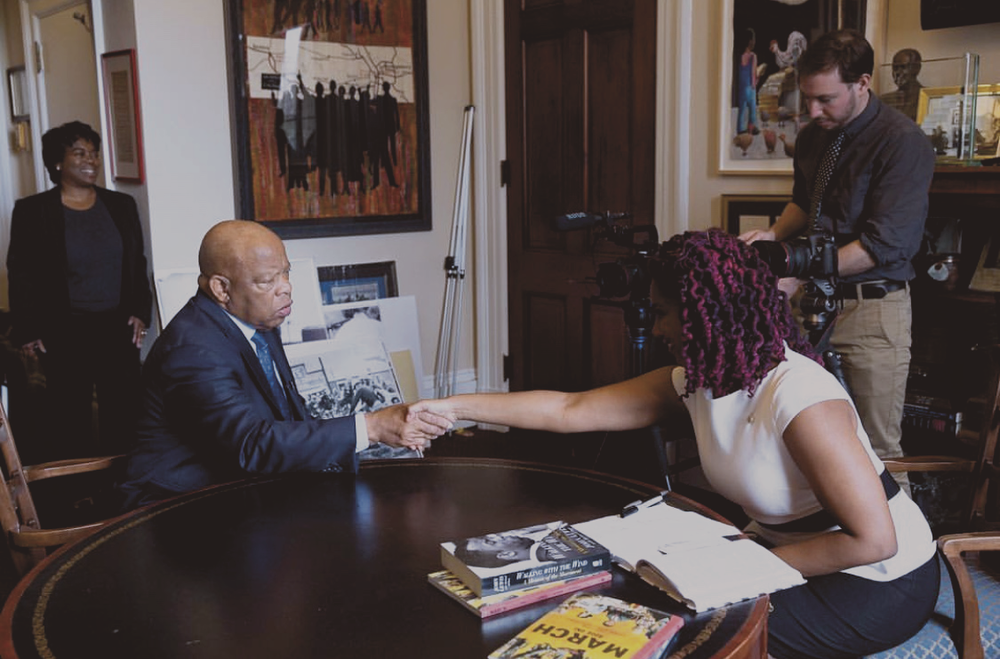 Kai Frazier interviewing John Lewis. She says he inspired her to get her career to this point •