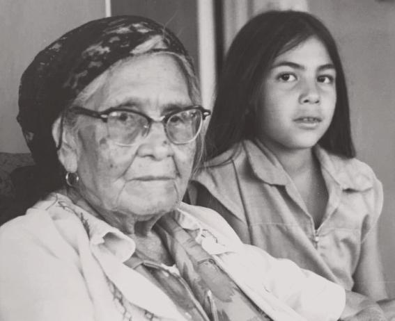 Young Felicia Cocotzin Ruiz with her grandmother •