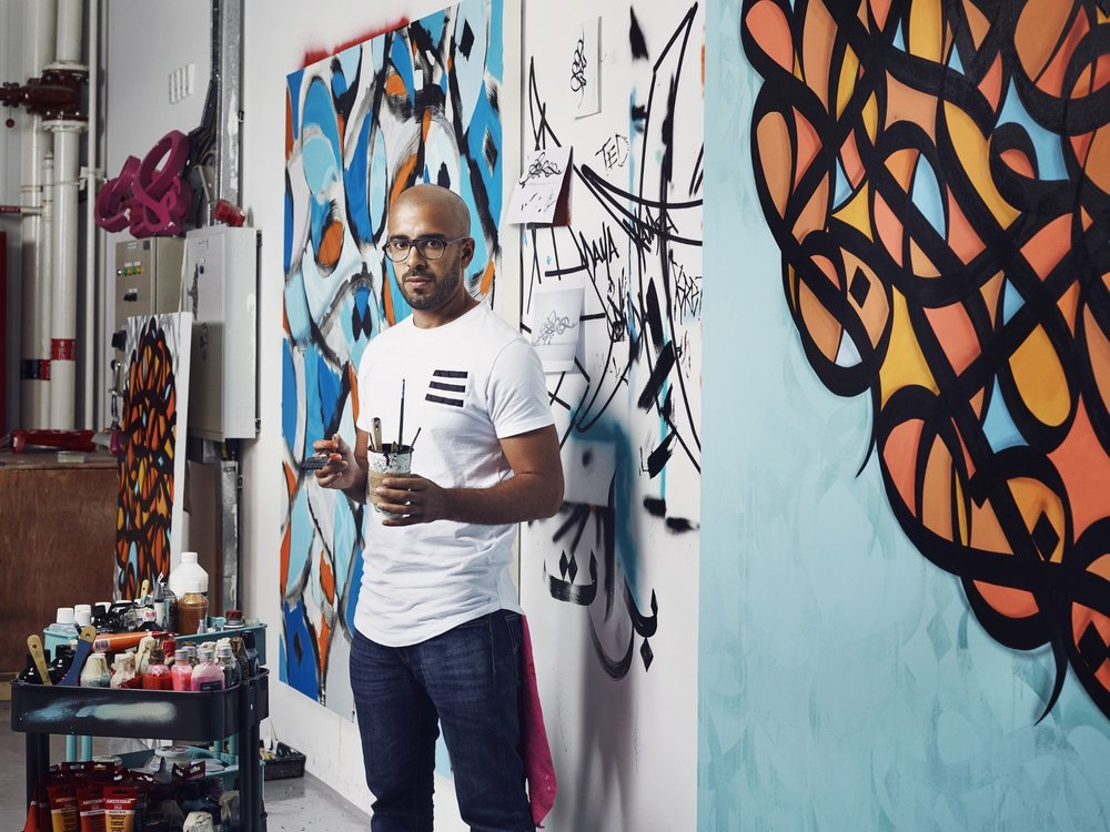 eL Seed - eL Seed is a French-Tunisian contemporary artist, working with Arabic script in 2 and 3 dimensions. He blends the historic art of Arabic calligraphy with graffiti to portray messages of beauty, poetry and peace across all continents. eL Seed is a 2014 TED Fellow, and a 2017 UNESCO Sharjah Prize for Arab Culture recipient.