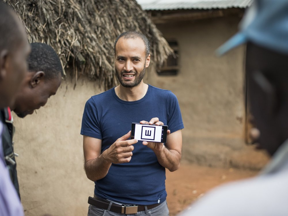 A doctor demonstrating the Peel vision check app in Kenya