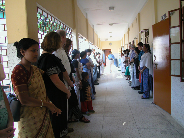 Morning prayers in the hospital corridor