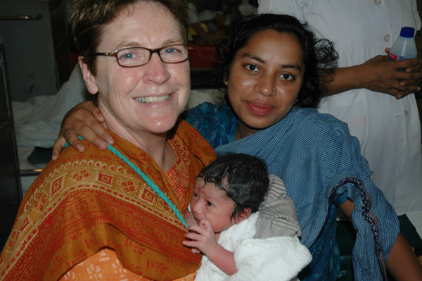 Nurse Deb with mother and newborn baby