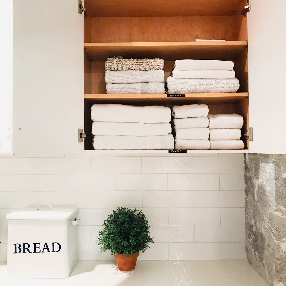 Organized towels in laundry room