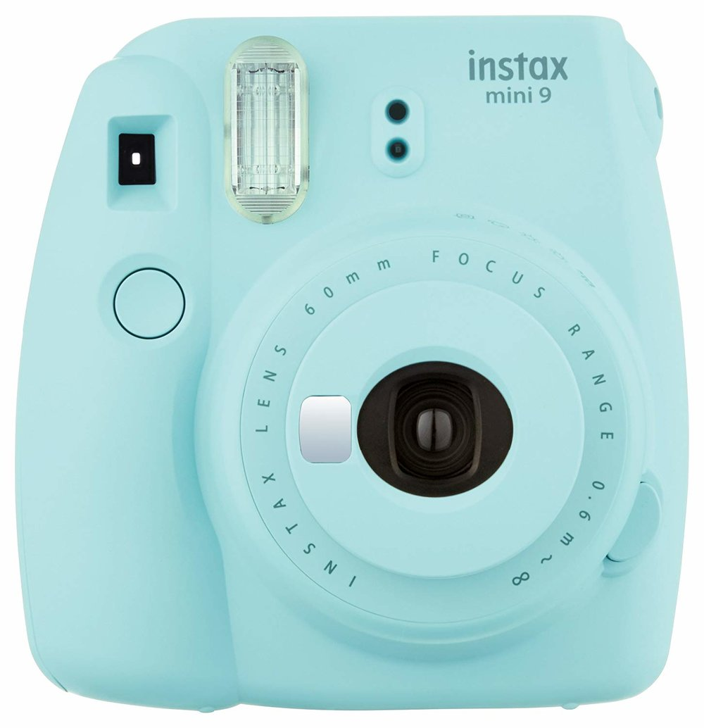 Fuji Film Instax Mini Instant Camera - I love that Fuji Film is keeping the polaroid dream alive. The color palette of these little beauties are so delightful and the photos somehow always come out effortlessly cool.