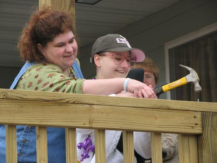 Dee Dee and Gypsy receiving their new home from Habitat for Humanity.