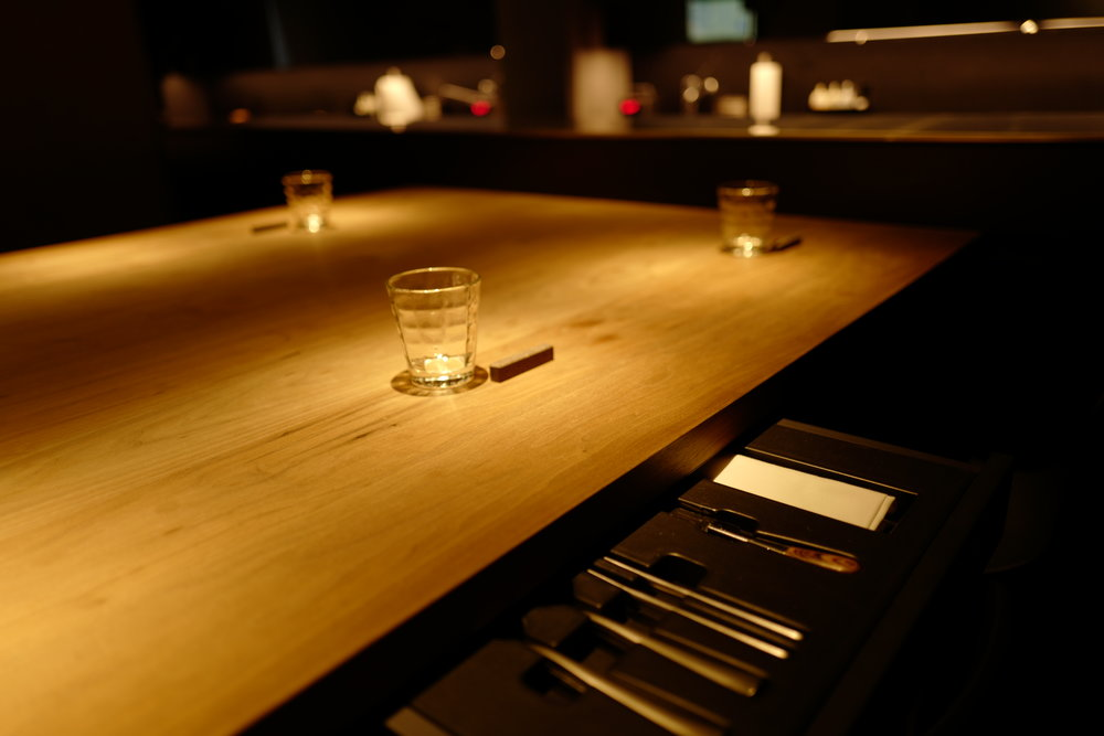 Tables with cutlery drawers for each diner.