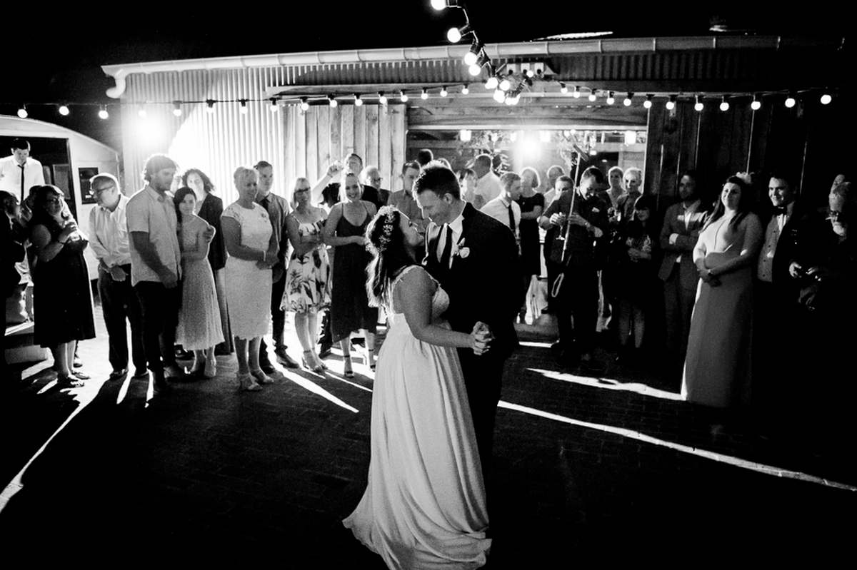 Black and white of bride and groom having a first dance. Photography by Anna Munro.