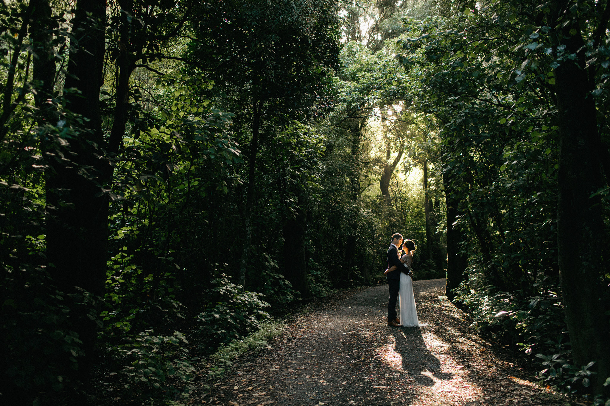 Bride and groom in forest at Rose & Smith