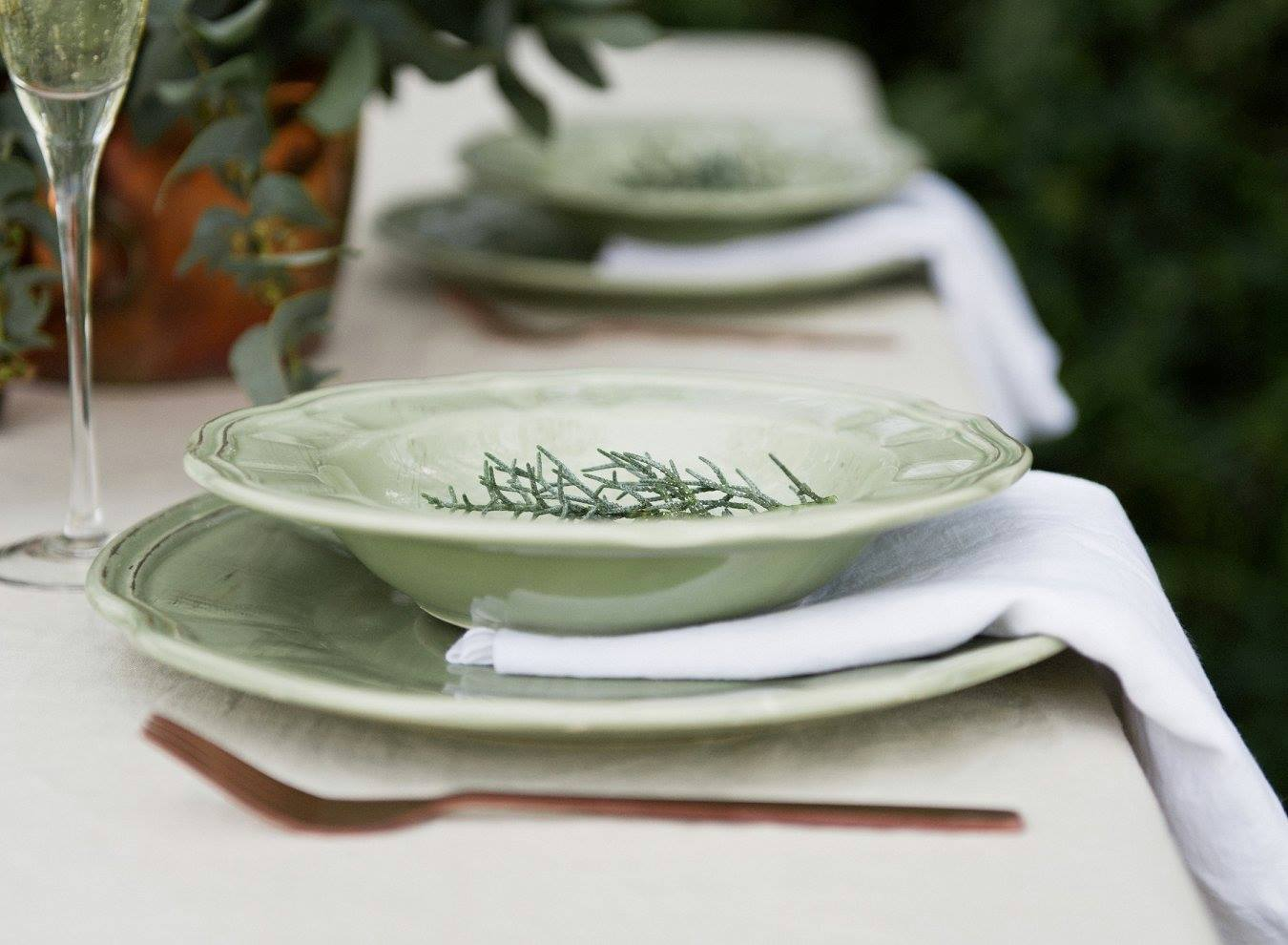 Green and white botanical table setting