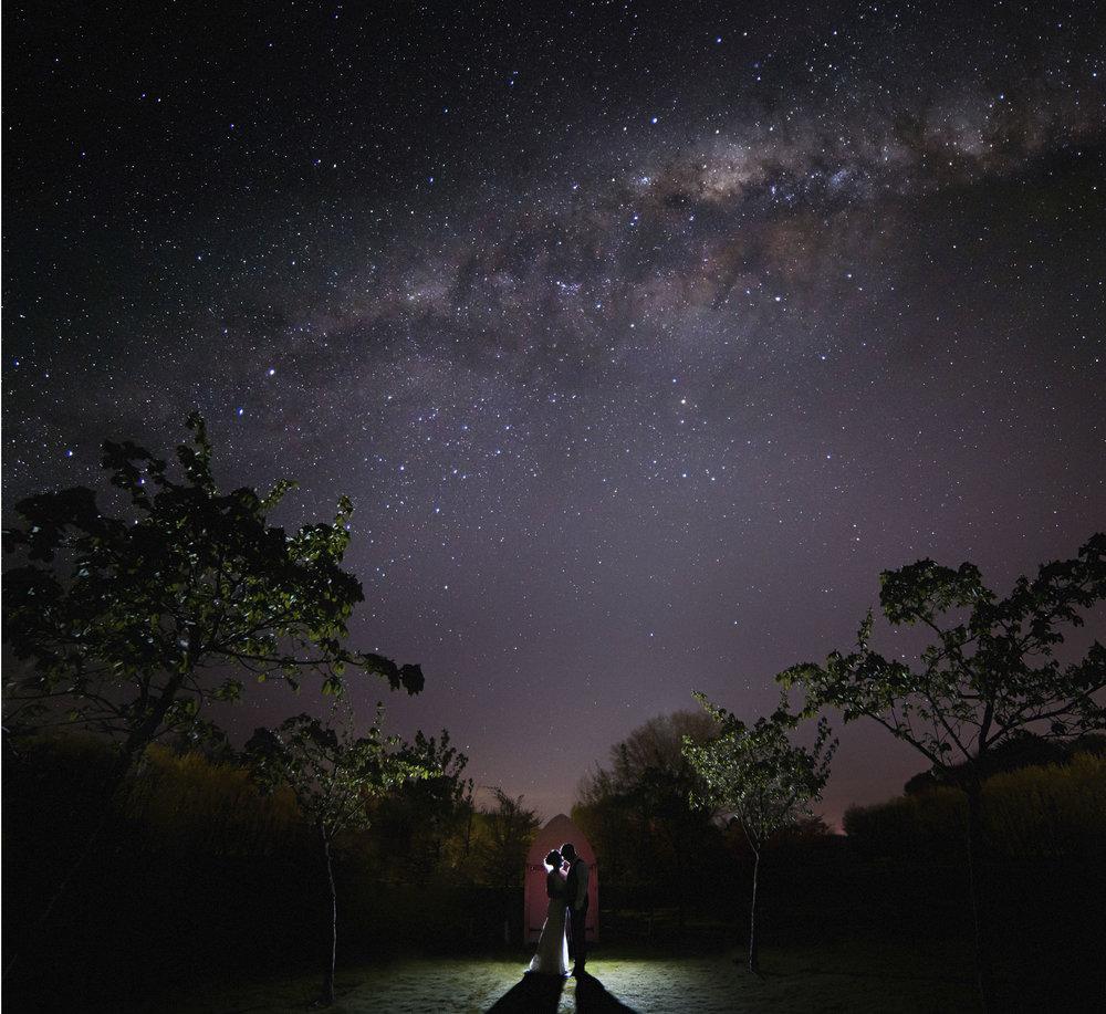 Wedding couple under starry sky