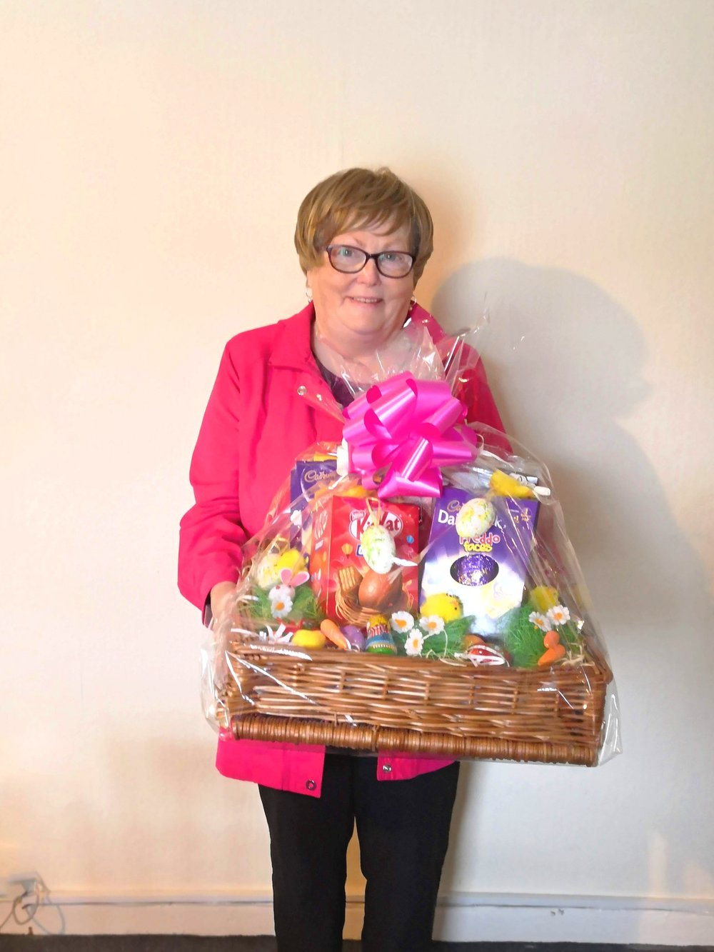 Patricia Hurley accepting hamper on behalf of their grandchild, Emma Hurley.
