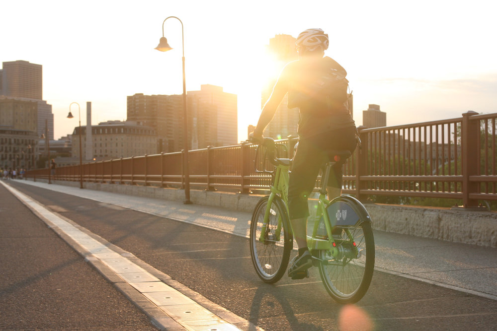 Green bike rider in sunset.jpg