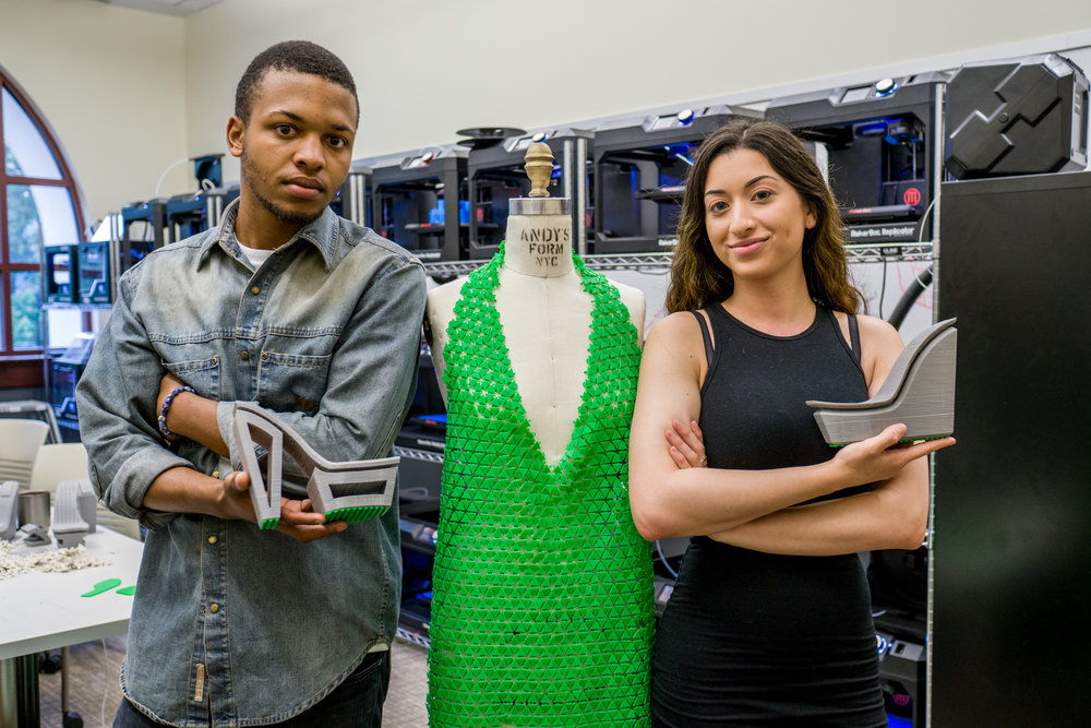 Altarik Banks and Natalie Rodriguez with the dress, inside MIX Lab. (Photo by Mike Peters)